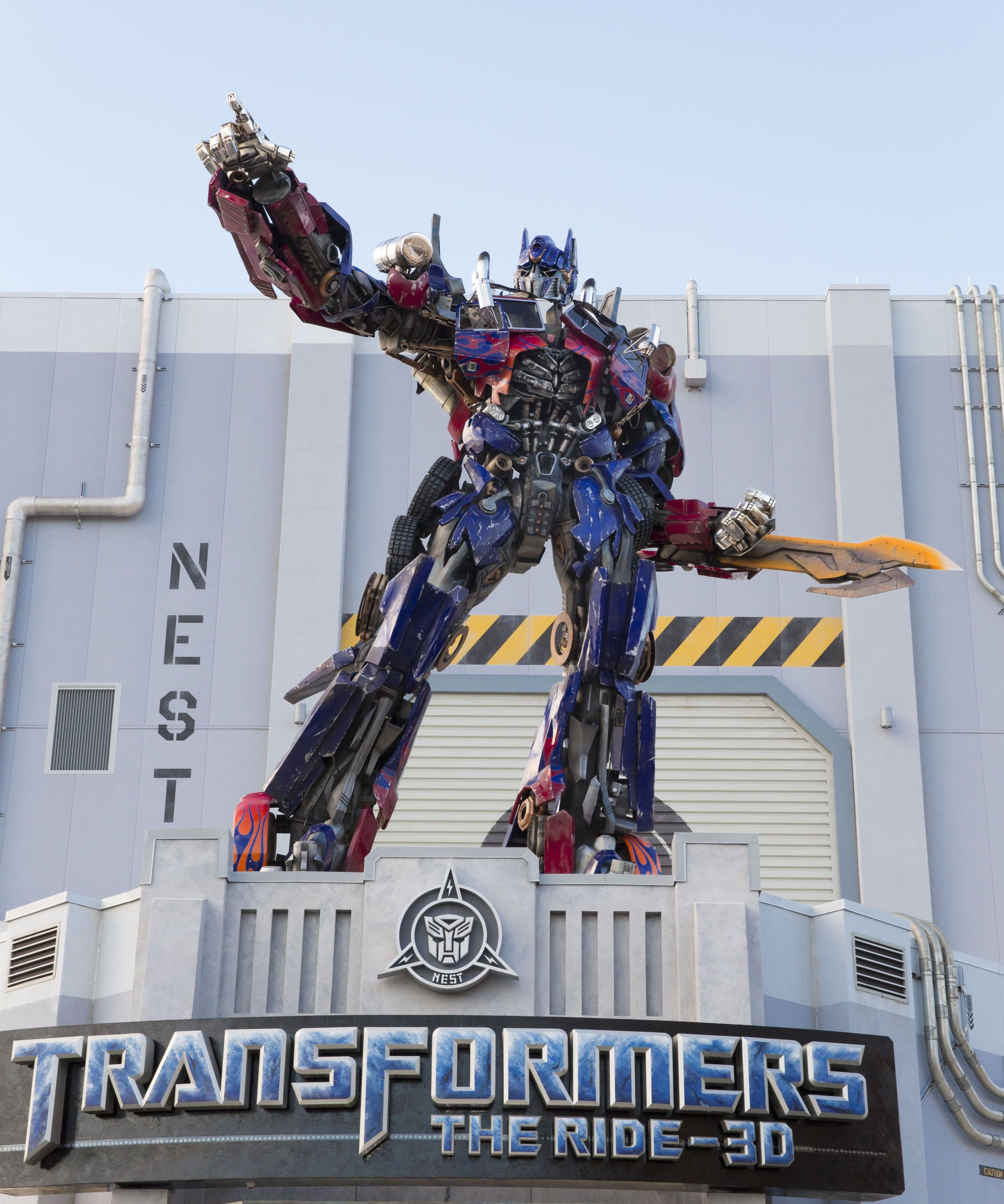life-size optimus prime added to the entrance of transformers: the